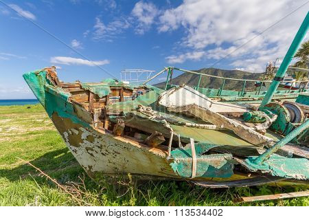 Derelict Fishing Boat Out Of Sea In Afternoon Light In  Pomos Harbor, Cyprus