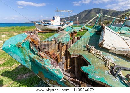 Derelict Fishing Boats Out Of Sea In Afternoon Light In  Pomos Harbor, Cyprus