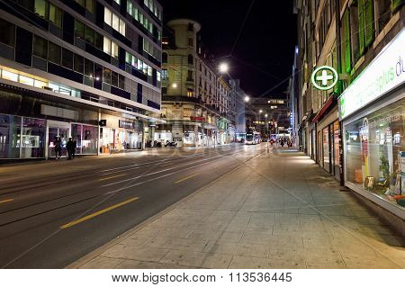 GENEVA, SWITZERLAND - NOVEMBER 18, 2015: streets of Geneva at night. Geneva is the second most populous city in Switzerland, after Zurich, and is the most populous city of Romandy