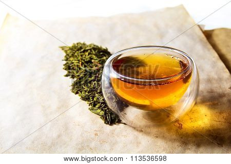 Double glass tea cup filled with green tea
