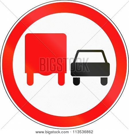 Road Sign Used In Russia - No Overtaking By Heavy Goods Vehicles