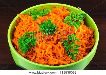 Spicy Salad Of Grated Carrots In Bowl On Wooden Background