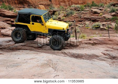 Jeep Travels Down Rugged Moab Rim Trail