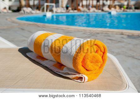 Beach Towel On The Bright Sun Lounger