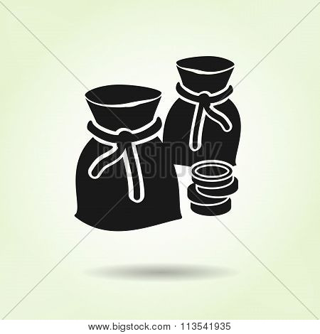 Money icon. Sacks of coins. Currency symbol. Black silhouette on light green background with shadow.