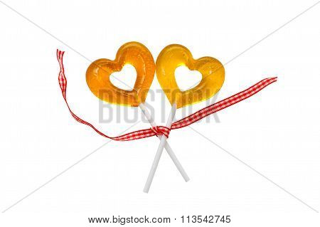 two yellow lollipop in heart shape
