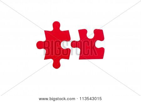 two red jigsaw pieces