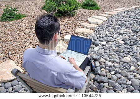 Student Works On A Laptop Computer