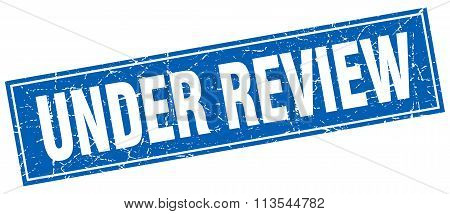 Under Review Blue Square Grunge Stamp On White