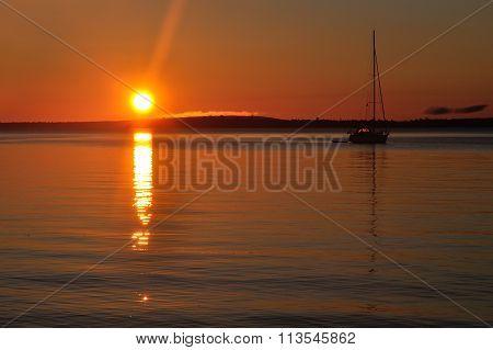 Sailboat Moored At Sunrise
