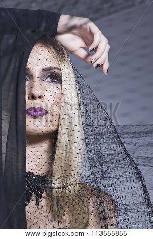 Fashionable Blonde Wrapped In A Veil