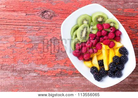 Plate Of Fruit On Old Table