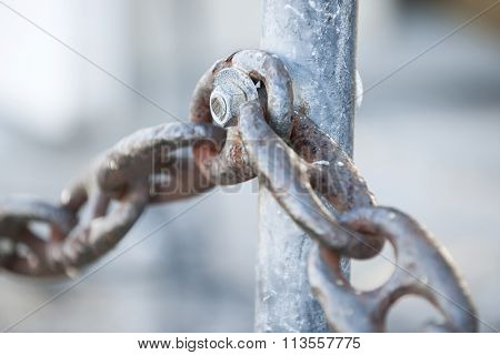 Fragment of rusty metal chain railing in Key West harbor, Florida.