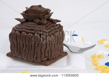 Square Mini Chocolate Cup Cake Cake on a candy bar