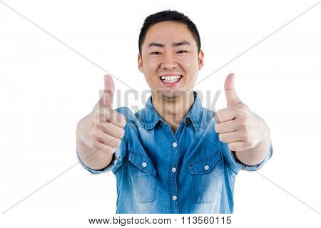 Portait of man showing thumbs up against white background