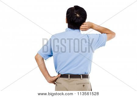 Rear view of man scratching head against white background