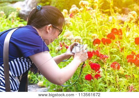 Female Photographer With Professional Digital Camera.