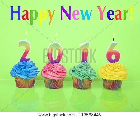 Rainbow cupcakes on green reflective surface Happy New Year 2016