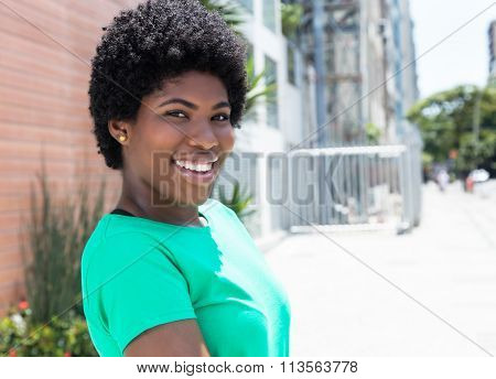 African Woman In A Green Shirt In The City