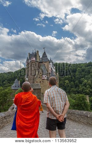 Escorted Buddhist Monk Shooting Eltz Castle In Münstermaifeld, Germany