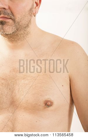 man with nipple piercing