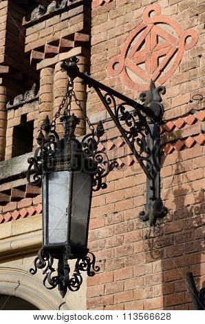 Old Street Lantern On The Brick Wall Of Former Archiepiscopal Residence Complex,chernivtsi ,Ukraine