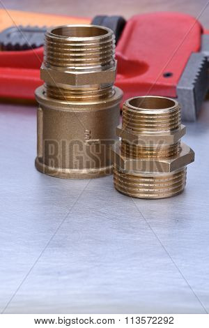 Equipment Plumbing & Heating Contractors, brass plumbing parts with wrench