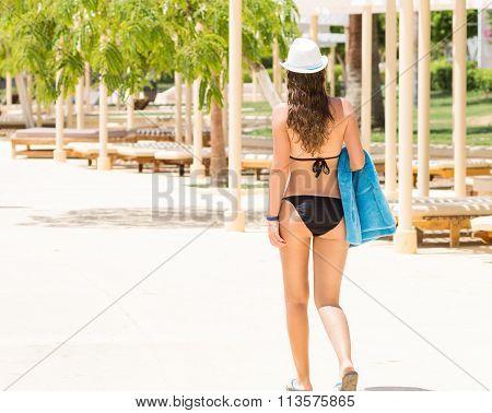 Slim Woman In Black Bikini