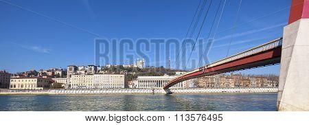 Saone River At Lyon With Red Footbridge