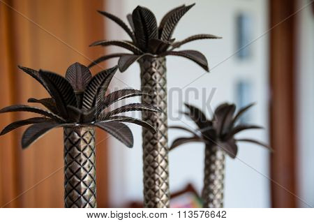 Small palm tree metal decoration on table