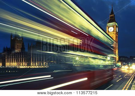 Bus Crossing The Bridge In Front Of Big Ben By Night