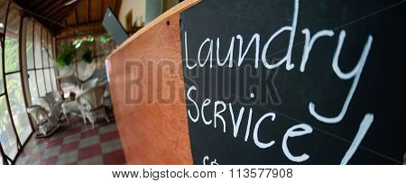 Closeup of Laundry Service sign black board with chalk