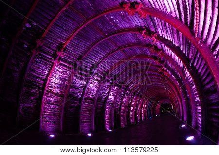 Purple light tunnel in underground salt cathedral Zipaquira