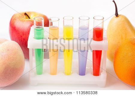 Fruit close chemical test tubes. Genetic Engineering. pesticides in foods