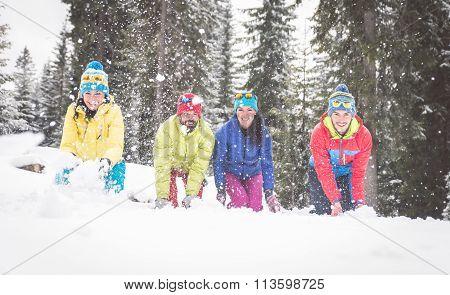 Friends having fun with snow