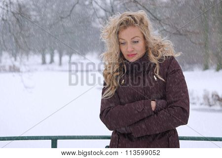 sad woman freezing in winter