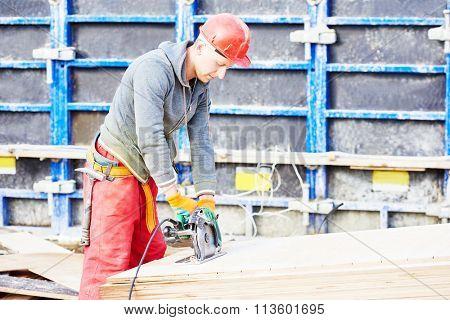 worker carpenter joiner at building site