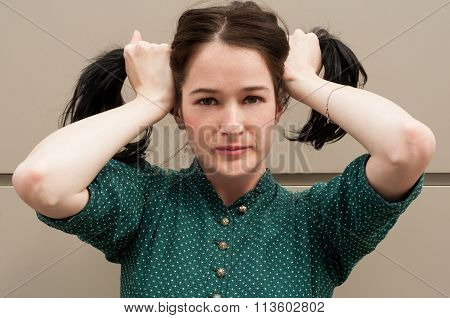 Young Female Model With Natural Look Making Pigtails Or Ponytails.
