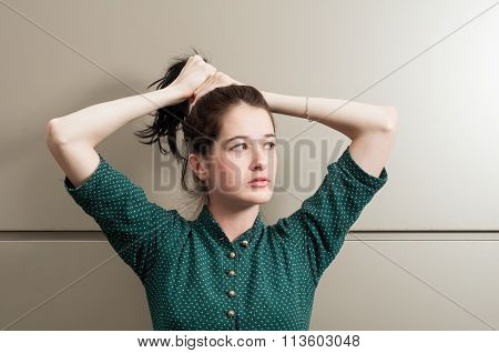 Young Female Model Grasping Her Hair .
