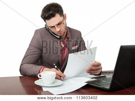 Business Manager Talking On The Phone While Reading Documents.