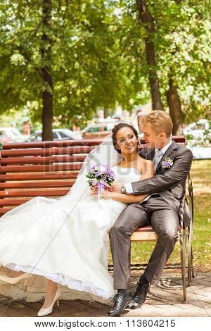 Bride and groom on the bench