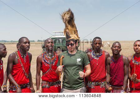 MASAI MARA, KENYA - FEB 2015 - Tourist visits village. Tribe, dressed in national costume, ceremony