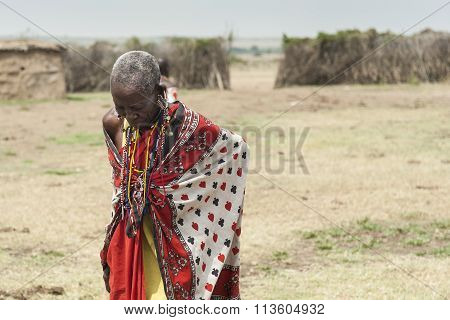 MASAI MARA, KENYA - FEB 2013: Tribe old women looks down in village