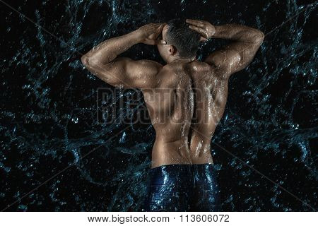 Water On The Back Of A Bodybuilder.