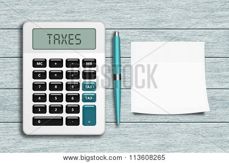 Calculator With Taxes Text, Pen, And Empty Note Lying On Wooden