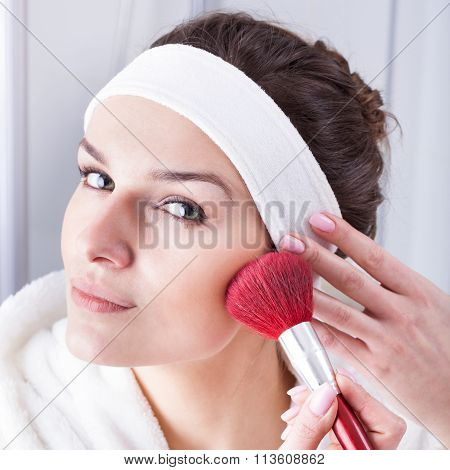 Beautiful young woman during the morning preparations
