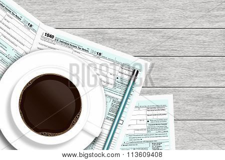 1040 Tax Form With Coffee Lying On Wooden Desk