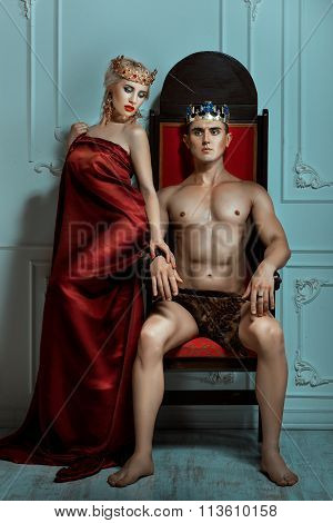 Man King Sitting On The Throne Beside Queen Woman.