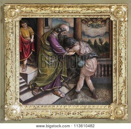 STITAR, CROATIA - NOVEMBER 24: Return of the prodigal son, Relief on main altar in the church of Saint Matthew in Stitar, Croatia on November 24, 2015