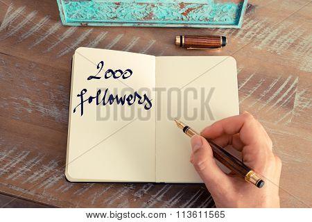 Motivational Concept With Handwritten Text 2000 Followers